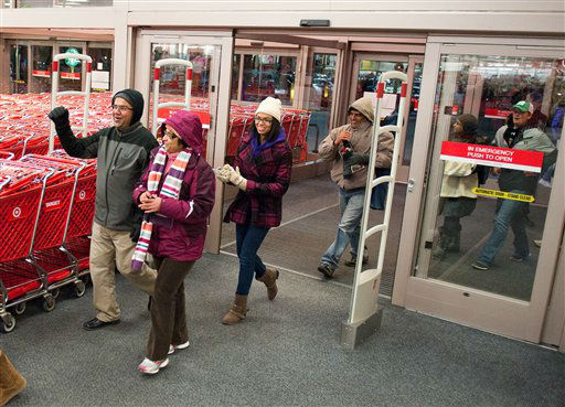 "<div class=""meta ""><span class=""caption-text ""> Black Friday shoppers rush in as doors open at 8 pm after waiting hours in line at Target, Thursday, Nov. 28, 2013 in Minnetonka, Minn.  (AP Photo/ Craig Lassig / AP Images for Target)</span></div>"