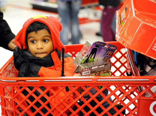 Jervis Benjamin, 8, of Wayzata, Minn. rides in a cart while he and his parents shop Target&#39;s Black Friday sale, Thursday, Nov. 28, 2013 in Minnetonka, Minn.  <span class=meta>(AP Photo&#47; Craig Lassig &#47; AP Images for Target)</span>