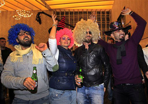 Lebanese revelers celebrate the New Year during a countdown event in downtown Beirut, Lebanon, Tuesday, Jan. 1, 2013.  <span class=meta>(AP Photo&#47; Bilal Hussein)</span>