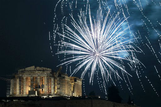 Fireworks explode over the ancient Parthenon temple at the Acropolis Hill  during the New Year&#39;s celebrations in Athens, on Tuesday Jan. 1, 2013.  <span class=meta>(AP Photo&#47; Petros Giannakouris)</span>