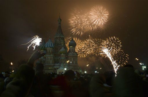 Fireworks explode in the sky over St. Basil Cathedral as Russians celebrate New Year on Red Square in Moscow, Russia, on Tuesday, Jan. 1, 2013.  <span class=meta>(AP Photo&#47; Ivan Sekretarev)</span>