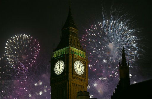 "<div class=""meta ""><span class=""caption-text "">Fireworks explode over Elizabeth Tower housing the Big Ben clock to celebrate the New Year in London, Tuesday, Jan. 1, 2013.  (AP Photo/ Kirsty Wigglesworth)</span></div>"