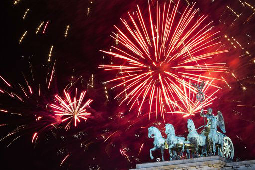 Fireworks explode in the sky above the  Quadriga on the Brandenburg Gate during the New Year&#39;s celebrations in Berlin, Tuesday, Jan. 1, 2013.  <span class=meta>(AP Photo&#47; Markus Schreiber)</span>