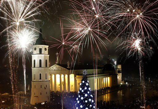 "<div class=""meta ""><span class=""caption-text "">Fireworks light the sky above the Cathedral Square in Vilnius shortly after midnight, greeting the New Year, Tuesday, Jan. 1, 2013.  (AP Photo/ Mindaugas Kulbis)</span></div>"