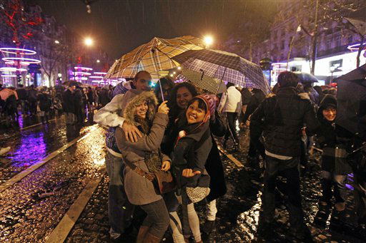 Revelers celebrate the New Year on the Champs Elysee in Paris, Tuesday Jan. 1, 2013. <span class=meta>(AP Photo&#47; Remy de la Mauviniere)</span>
