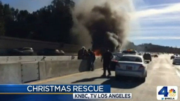 LAPD officer Don Thompson wasn&#39;t even on duty yet when he saved a man from a   horrifying, fiery crash on Christmas Day.  A 72-year-old man lost control of his car and it smashed into the center divider of the 405 freeway, then burst into flames. Thompson happened to be driving by on his way to work and leapt into action. With the help of a Los Angeles firefighter who was also driving by, Thompson pulled the man from the car. Thompson suffered some first and second-degree burns, but he is OK. Talk about a Christmas Miracle.   Right attitude quote: &#34;Thank goodness I found that button and popped the belt, and grabbed him and pulled him out.&#34; <span class=meta>(Photo&#47;KTRK)</span>