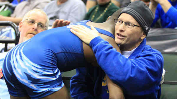 "<div class=""meta image-caption""><div class=""origin-logo origin-image ""><span></span></div><span class=""caption-text"">              High school wrestler's hug wins the crowd after a loss      His priority:     Showing compassion, win or lose       Picture this: You're a sophomore in high school and you just lost a wrestling match - a big one, at that. A lot of us might be inclined to throw a fit, or     at the very least storm away without a word. Not Malik Stewart. His thoughts went to his opponent's father, who is dying of cancer. Having lost his own dad, Stewart decided the winner's dad might need a hug,    so that's just what he gave him.       Stewart said he still wants to win a title in the future, and we have a feeling the crowd will be rooting for him.   (Photo/AP)</span></div>"