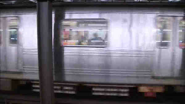 A mystery man is making headlines after surviving a run-in with a subway car.       Officials would like to find the man, who dropped his cell phone on the tracks and climbed down to get it. They think part of a train ran over the man while he was down there, but they didn&#39;t get to talk to him. After he climbed back up, he    walked right out of the station.  <span class=meta>(WABC)</span>