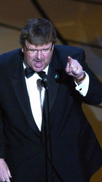 "<div class=""meta image-caption""><div class=""origin-logo origin-image ""><span></span></div><span class=""caption-text"">That time when Michael Moore's acceptance speech started out normal and then...  Moore made some strong statements against the war in Iraq. Some audience members booed and some cheered, but most just sat in uncomfortable silence. His time ran out as he exclaimed, ""Shame on you, Mr. Bush!""  Year: 2003 (Photo/KEVORK DJANSEZIAN)</span></div>"