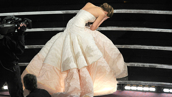 "<div class=""meta image-caption""><div class=""origin-logo origin-image ""><span></span></div><span class=""caption-text"">That time when Jennifer Lawrence won her first Oscar and then...  J-Law stumbled on her giant dress as she walked on stage to accept the award for best actress in a leading role for ""Silver Linings Playbook."" She reached the microphone to a standing ovation, then accused the audience, ""You guys are just standing up because you feel bad that I fell, and that's really embarrassing, but thank you.""  Year: 2013 (AP)</span></div>"
