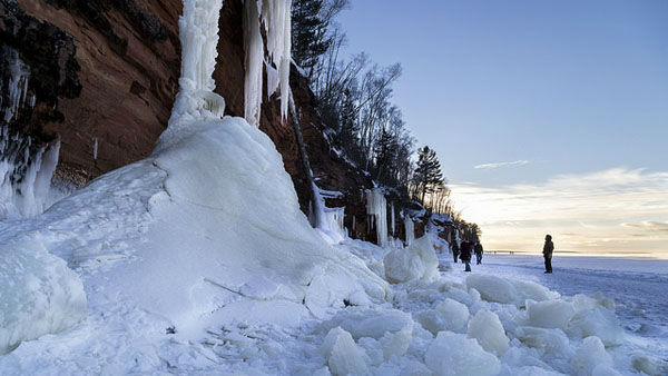 Explorers this year are taking advantage of an infrequent natural phenomenon. Lake Superior is so frozen that certain areas are safe to walk on. That means visitors can hike out to the dazzling display of frozen terrain along the    Apostle Islands National Lakeshore including caves, cliffs and frozen waterfalls.       Weather conditions have not been right for this since 2009, and the trek is rarely possible before February, as it was this year.   Andy Rathbun of the    St. Paul Pioneer Press, who shot these     photos, said he won&#39;t soon forget his first visit to the caves.       ?Standing atop the frozen crust of the largest freshwater lake in the world - by surface area - and hearing the pops and pings of the ice as it moves ever     so slightly under massive force is a great experience,? he said.       See more of Rathbun&#39;s work on Flickr.  <span class=meta>(Photo&#47;Andy Rathbun, Pioneer Press)</span>