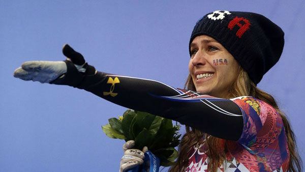 5. And then there are the happy tears. So many happy tears. Noelle Pikus-Pace of the United States during the flower ceremony after winning the silver medal during the women&#39;s skeleton competition  <span class=meta>(Photo&#47;Dita Alangkara)</span>