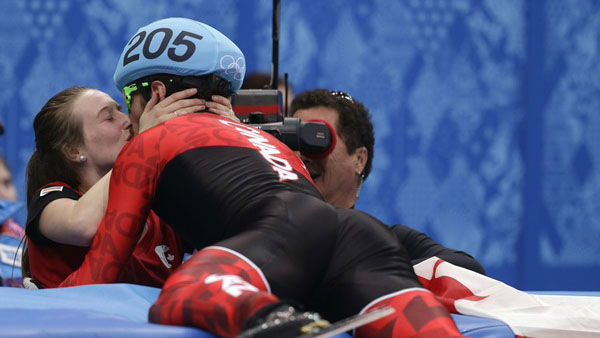 "<div class=""meta ""><span class=""caption-text "">9. You could race to kiss a loved one... Charles Hamelin of Canada, right, with Marianne St. Gelais after he won the men's 1500m short track speedskating  (Photo/Darron Cummings)</span></div>"