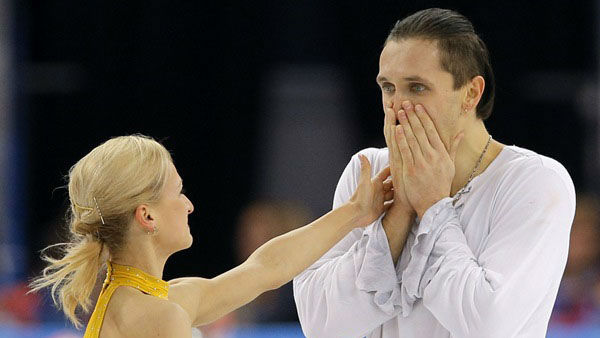 2. You could express your disbelief and exhilaration.  Gold medallists Tatiana Volosozhar and Maxim Trankov of Russia after a routine in pairs free skate figure skating competition <span class=meta>(Photo&#47;Vadim Ghirda)</span>