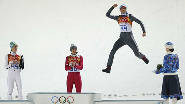 13. Then there&#39;s the popular podium jump.  Norway&#39;s bronze medal winner Anders Bardal after the men&#39;s normal hill ski jumping   <span class=meta>(Photo&#47;Matthias Schrader)</span>