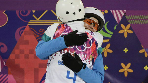 12. You could make some international friends. Women&#39;s freestyle skiing aerials gold medalist Alla Tsuper, facing camera, of Belarus, and bronze medalist Lydia Lassila, of Australia  <span class=meta>(Photo&#47;Jae C. Hong)</span>