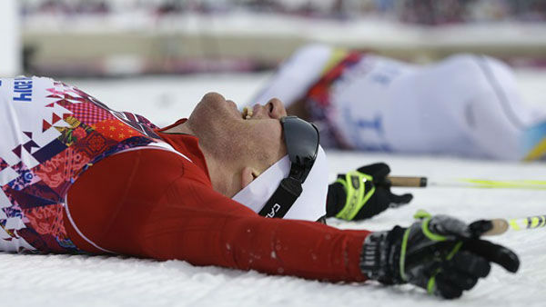 1. You could collapse in exhaustion and jubilation.  Switzerland&#39;s Dario Cologna after winning the men&#39;s cross-country 30k skiathlon <span class=meta>(Photo&#47;Gregorio Borgia)</span>