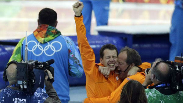 11. Don&#39;t forget about your coach! Stefan Groothuis of the Netherlands with his coach after he won gold for the men&#39;s 1000-meter speedskating  <span class=meta>(Photo&#47;David J. Phillip)</span>