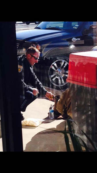 This photo of an act of kindness between a Texas police officer and a homeless man quickly went viral this week. Corporal Jeremy Walsh told KTRK the homeless man is someone he&#39;s come to know while on patrol. When he noticed that the man didn&#39;t have any shoes, he decided to give him a pair of boots. Walsh is still trying to convince the man that he doesn&#39;t expect anything in return.   Good attitude quote: &#34;I figured AJ could use them a lot more than I could.&#34;  <span class=meta>(Photo&#47;KTRK)</span>
