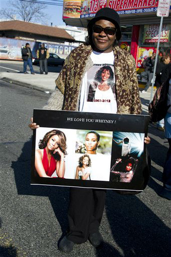 A fan holds a picture of Whitney Houston near the funeral services for the singer at the New Hope Baptist Church in Newark, N.J., Saturday, Feb. 18, 2012. <span class=meta>(AP Photo&#47; Charles Sykes)</span>