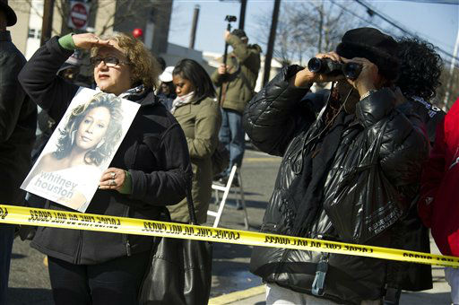 "<div class=""meta ""><span class=""caption-text "">Fans are kept three blocks from the Whitney Houston funeral in Newark, N.J., Saturday, Feb. 18, 2012.  (AP Photo/ Charles Sykes)</span></div>"