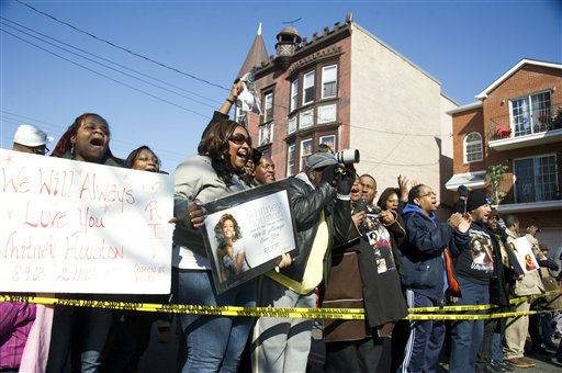 Fans sing near funeral services for Whitney Houston at the New Hope Baptist Church in Newark, N.J., Saturday, Feb. 18, 2012.  <span class=meta>(AP Photo&#47; Charles Sykes)</span>