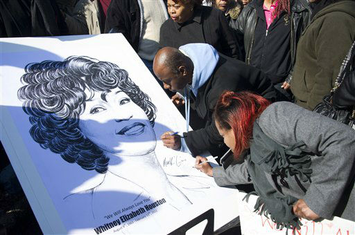 Fans sign a poster showing a picture of Whitney Houston near a funeral service for the singer at the New Hope Baptist Church in Newark, N.J., Saturday, Feb. 18, 2012.  <span class=meta>(AP Photo&#47; Charles Sykes)</span>