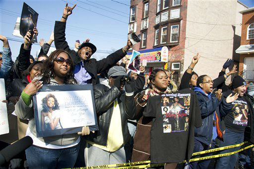 "<div class=""meta ""><span class=""caption-text "">Fans sing near funeral services for Whitney Houston at the New Hope Baptist Church in Newark, N.J., Saturday, Feb. 18, 2012. (AP Photo/ Charles Sykes)</span></div>"