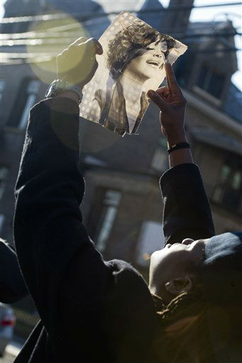A fan holds up a picture of Whitney Houston near the funeral services for the singer at the New Hope Baptist Church in Newark, N.J., Saturday, Feb. 18, 2012.  <span class=meta>(AP Photo&#47; Charles Sykes)</span>