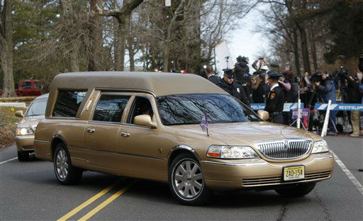 "<div class=""meta ""><span class=""caption-text "">The hearse carrying the body of Whitney Houston arrives at Fairview Cemetery for her burial in Westfield, N.J., Sunday, Feb. 19, 2012.  (AP Photo/ Rich Schultz)</span></div>"