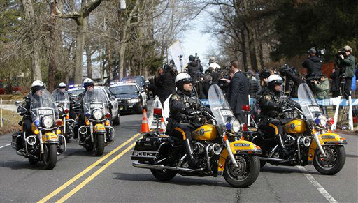 A Newark Police Department motorcade escorts the hearse carrying the body of Whitney Houston arrives at Fairview Cemetery for her burial in Westfield, N.J., Sunday, Feb. 19, 2012.  <span class=meta>(AP Photo&#47; Rich Schultz)</span>