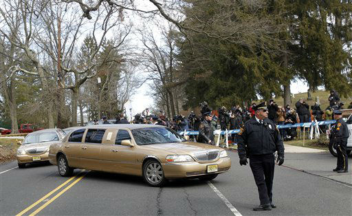 "<div class=""meta ""><span class=""caption-text "">A long line of limos follow the hearse carrying the body of Whitney Houston arrives at Fairview Cemetery for her burial in Westfield, N.J., Sunday, Feb. 19, 2012.  (AP Photo/ Rich Schultz)</span></div>"