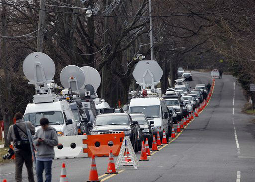 A long line of media vehicles line up to cover the burial of Whitney Houston at Fairview Cemetery for her burial in Westfield, N.J., Sunday, Feb. 19, 2012.  <span class=meta>(AP Photo&#47; Rich Schultz)</span>