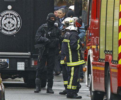 French special intervention police officers of Research Assistance Intervention Dissuasion unit, and firefignters are seen near a building where the chief suspect in an al-Qaida-linked killing spree was holed up in an apartment in Toulouse, France Thursday March 22, 2012.  <span class=meta>(AP Photo&#47; Remy de la Mauvinere)</span>