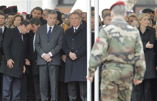 From left, Valerie Trierweiler companion of Socialist Party candidate for the French presidential election Francois Hollande, rightist candidate Nicolas Dupont-Aignan,  and centrist candidate Francois Bayrou, and  far-right candidate Marine Le Pen attend a ceremony to pay homage to the three soldiers killed by the suspected French gunman Mohamed Merah, claiming al-Qaida links, and also suspected in the killings of three Jewish children and a rabbi, Wednesday, March 21, 2012 in Montauban, southwestern France. Soldiers were Imad Ibn-Ziaten, 30, a paratrooper in the 1st Airborne Transportation Regiment based in Toulouse, Abel Chennouf, 25, who served in the 17th paratrooper combat engineering regiment based in Montauban and Mohamed Legouade, 26, the second paratrooper killed in the same shooting. Second man at left is unidentified. <span class=meta>(AP Photo&#47; Jacques Brinon)</span>