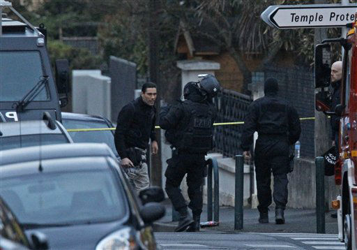 French special intervention police officers of Research Assistance Intervention Dissuasion unit, RAID, arrive at an apartment building in Toulouse, France, early Thursday, March 22, 2012 where Mohamed Merah, a suspect in the shooting at he Ozar Hatorah Jewish school, had been holed up.  <span class=meta>(AP Photo&#47; Remy de la Mauvinere)</span>