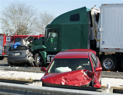 "<div class=""meta ""><span class=""caption-text "">Wrecked vehicles sit along the road at the scene of a multi-vehicle accident on Interstate 75 near Gainesville, Fla., Sunday, Jan. 29, 2012.  (AP Photo/ Phil Sandlin)</span></div>"