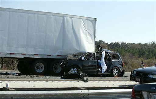 "<div class=""meta ""><span class=""caption-text "">A small passenger vehicle sits lodged beneath a semitrailer after a multi-vehicle accident on Interstate 75 near Gainesville, Fla., Sunday, Jan. 29, 2012.  (AP Photo/ Phil Sandlin)</span></div>"