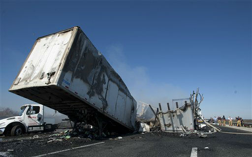 "<div class=""meta ""><span class=""caption-text "">Debris and wreckage lie along the highway after a multi-vehicle accident on Interstate 75 near Gainesville, Fla., Sunday, Jan. 29, 2012.  (AP Photo/ Phil Sandlin)</span></div>"