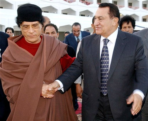 In this Feb. 28, 2003 file photo, Egyptian President Hosni Mubarak, right, accompanies Libyan leader Moammar Gadhafi upon his arrival at his hotel at the Red Sea resort of Sharm el-Sheik.  <span class=meta>(Photo&#47;HUSSEIN MALLA)</span>