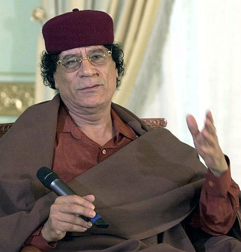 "<div class=""meta ""><span class=""caption-text "">Libyan leader Moammar Gadhafi gestures during a meeting with Tunisian political leaders at Gammarth, outside Tunis, Wednesday May 21, 2003.  (AP Photo/ HASSENE DRIDI)</span></div>"