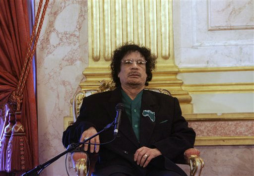 "<div class=""meta ""><span class=""caption-text "">Libyan leader Moammar Gadhafi meets with lawmakers, unseen, from France's lower house of Parliament, Tuesday, Dec. 11, 2007 in Paris.  (AP Photo/ CHRISTOPHE ENA)</span></div>"