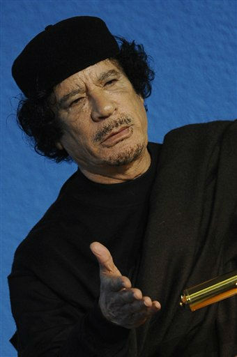 Libyan leader Moammar Gadhafi delivers his address at the inaugural ceremony of a World Summit on Food Security organized by the United Nations Food and Agriculture Organization &#40;FAO&#41;, in Rome, Monday, Nov. 16, 2009.  <span class=meta>(AP Photo&#47; FILIPPO MONTEFORTE)</span>