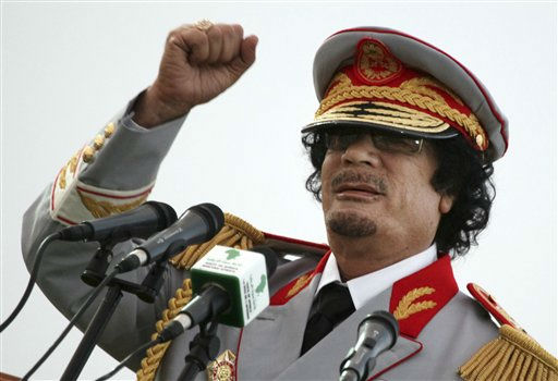 Libyan leader Moammar Gadhafi talks during a ceremony to mark the 40th anniversary of the evacuation of the American military bases in the country, in Tripoli, Saturday, June 12, 2010.  <span class=meta>(AP Photo&#47; Abdel Magid Al Fergany)</span>