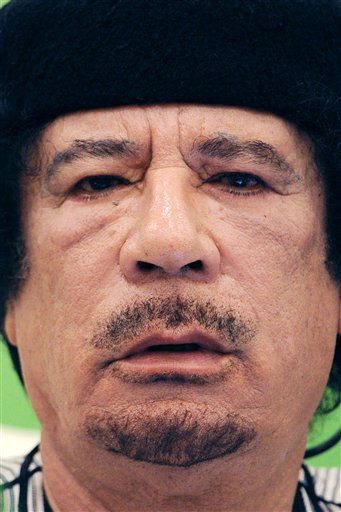 Libyan leader Moammar Gadhafi talks during the first session of the 3rd Africa-EU Summit in Tripoli, Libya, Monday Nov. 29, 2010.  <span class=meta>(Photo&#47;Geert Vanden Wijngaert)</span>