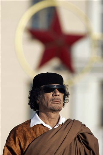 "<div class=""meta image-caption""><div class=""origin-logo origin-image ""><span></span></div><span class=""caption-text"">In this photo taken Monday, Nov. 3, 2008, Libya's leader Moammar Gadhafi attends a wreath laying ceremony in the Belarus capital Minsk.  (AP Photo/ Sergei Grits)</span></div>"
