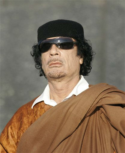 In this photo taken Monday, Nov. 3, 2008, Libya&#39;s leader Moammar Gadhafi attends a wreath laying ceremony in the Belarus capital Minsk.  <span class=meta>(AP Photo&#47; Sergei Grits)</span>