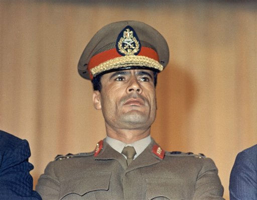 "<div class=""meta ""><span class=""caption-text "">In this 1970 file photo, Moammar Gadhafi is shown at the Cairo Airport in Cairo, Egypt.  (AP Photo)</span></div>"