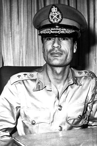 "<div class=""meta image-caption""><div class=""origin-logo origin-image ""><span></span></div><span class=""caption-text"">Premier of Libya Col. Moammar Gadhafi, 28, youngest head of state in the world since assuming power after the 1969 coup, is shown in 1970 at an unknown location.   (AP Photo/ XNBG)</span></div>"