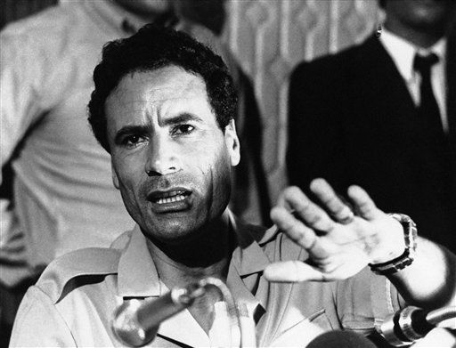 "<div class=""meta ""><span class=""caption-text "">Libyan Leader Colonel Moammar al-Gadhafi addresses newsman at a press conference at the Palais des Nations conference hall in Aligiers, Sept. 7, 1973.  (AP Photo)</span></div>"